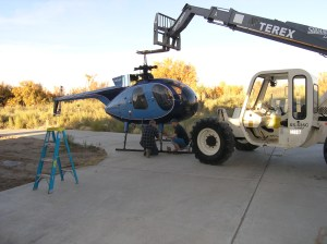 Hughes 500c helicopter ready for loading